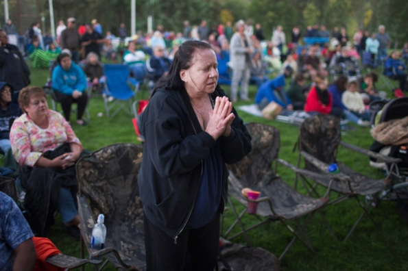 WINSTON, OR - OCTOBER 03: Nancy Peete prays during a prayer service and candlelight vigil at River Bend Park to remember the victims of the mass shooting at Umpqua Community College in nearby Roseburg on October 3, 2015 in Winston, Oregon. On Thursday 26-year-old Chris Harper Mercer went on a shooting rampage at the college killing nine people and wounding another nine before killing himself.   Scott Olson/Getty Images/AFP