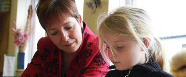 hero-education-reading-girl-teacher-phil-dowsing-creative-cc