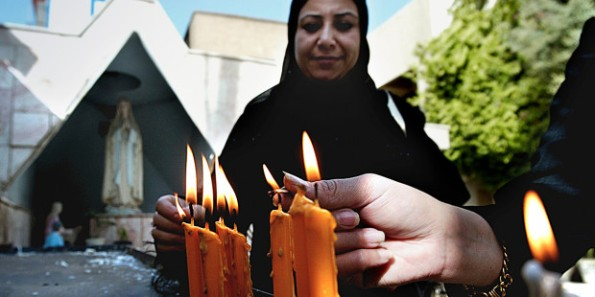 web3-blessed-mother-mary-islam-muslim-women-candles-000_nic96910-wisam-sami-afp